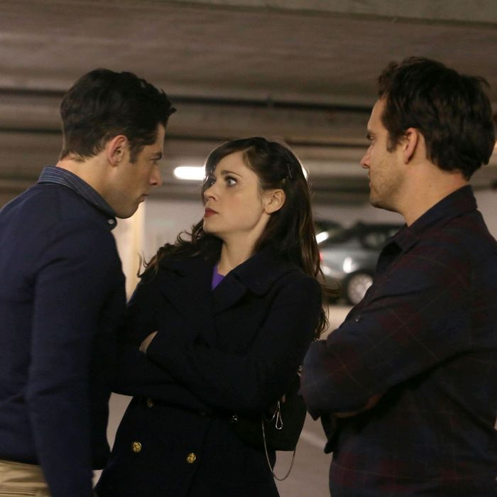 NEW GIRL: L-R: Schmidt (Max Greenfield), Jess (Zooey Deschanel) and Nick (Jake Johnson) battle it out for a newly discovered parking spot in their building in the