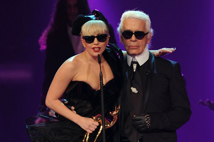 WIESBADEN, GERMANY - NOVEMBER 10:  Lady Gaga receives the Pop International award from Karl Lagerfeld during the Bambi Award 2011 show at the Rhein-Main-Hallen on November 10, 2011 in Wiesbaden, Germany.  (Photo by Christian Augustin/Getty Images)