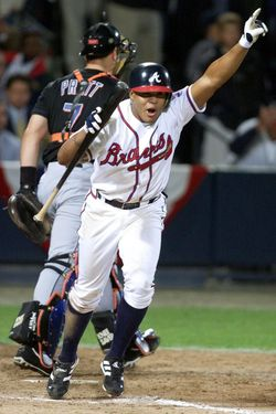 ATLANTA, UNITED STATES:  Andruw Jones (R) of the Atlanta Braves celebrates after taking a walk in the 11th inning against the New York Mets as Mets catcher Todd Pratt (L) walks back to the bench 19 October, 1999 during game six of the National League Championship Series at Turner Field in Atlanta, GA. The Brave won the game 10-9 to win the best-of-seven game series 4-2.  (ELECTRONIC IMAGE)  AFP PHOTO/Jeff HAYNES (Photo credit should read JEFF HAYNES/AFP/Getty Images)