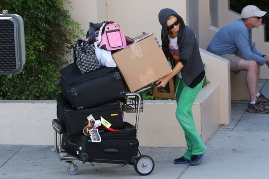 121518, EXCLUSIVE: Paris Hilton pushes a cart full of luggage as she arrives at Burbank airport. Los Angeles, California - Monday June 23, 2014. Photograph: Juan Sharma/Bruja, ? PacificCoastNews. Los Angeles Office: +1 310.822.0419 London Office: +44 208.090.4079 sales@pacificcoastnews.com FEE MUST BE AGREED PRIOR TO USAGE
