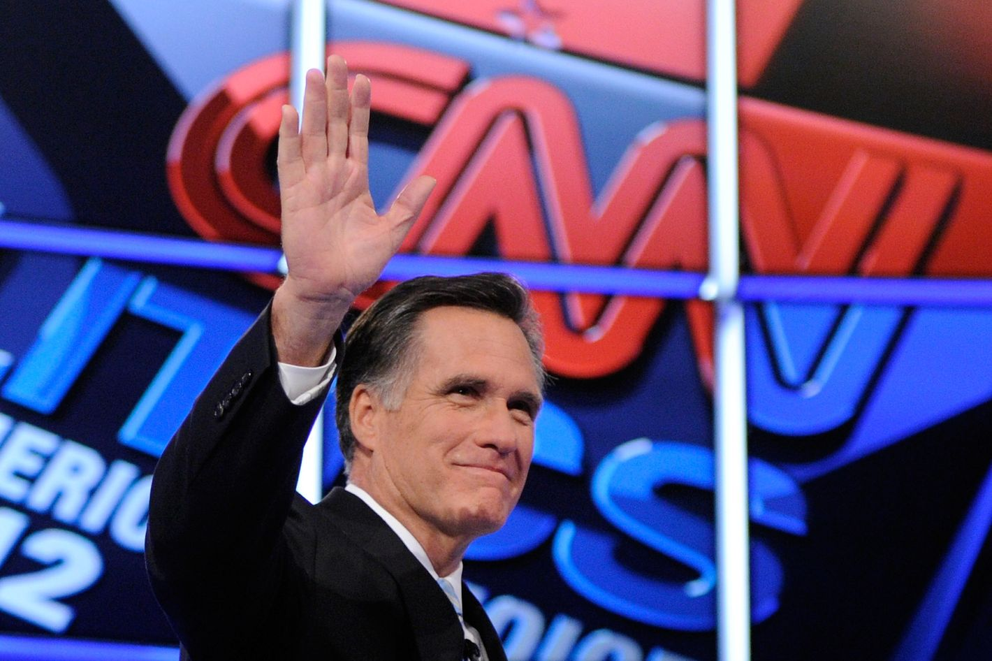 MESA, AZ - FEBRUARY 22:  Republican presidential candidate, former Massachusetts Gov. Mitt Romney waves as he is introduced at a debate sponsored by CNN and the Republican Party of Arizona at the Mesa Arts Center February 22, 2012 in Mesa, Arizona. The debate is the last one scheduled before voters head to the polls in Michigan and Arizona's primaries on February 28 and Super Tuesday on March 6.  (Photo by Ethan Miller/Getty Images)