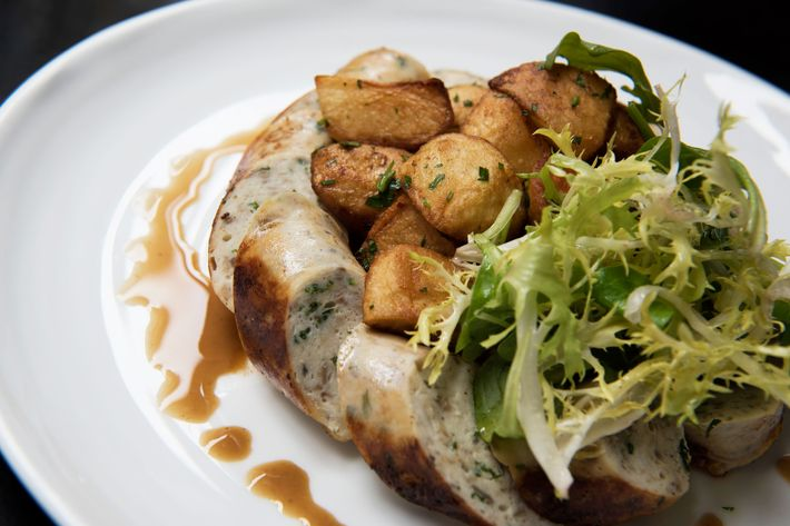 Homemade chicken-and-mushroom sausage with fried garlic, parsley potatoes, and green salad.