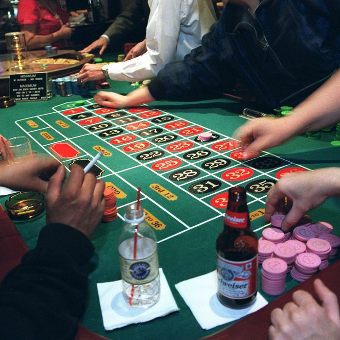 F365119 09: Gamblers place their bets at the roulette table at the Golden Gate Hotel & Casino in Las Vegas, a town of excess, June 15, 1999. Golden Gate Hotel & Casino is the city's oldest hotel (1906) and home of the original 99-cent shrimp cocktail. (photo by Theo Westenberger)