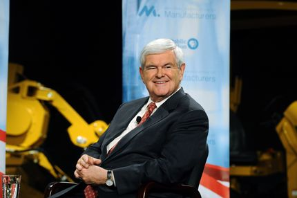 PELLA, IA - NOVEMBER 1:  Former Speaker of the House and Republican presidential candidate Newt Gingrich smiles during a forum on manufacturing November 1, 2011 at Vermeer Manufacturing in Pella, Iowa. Five of the Republican candidates, excluding Herman Cain and former Massachusetts Gov. Mitt Romeny who declined to come, are slated to appear at the forum.   (Photo by Steve Pope/Getty Images)