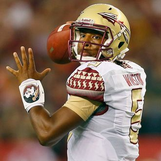 ARLINGTON, TX - AUGUST 30: Jameis Winston #5 of the Florida State Seminoles passes against the Oklahoma State Cowboys in the first half of the Advocare Cowboys Classic at AT&T Stadium on August 30, 2014 in Arlington, Texas.