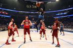 ORLANDO, FL - FEBRUARY 26:  Carmelo Anthony #15 of the New York Knicks and the Eastern Conference dunks Kobe Bryant #24 of the Los Angeles Lakers and the Western Conference during the 2012 NBA All-Star Game at the Amway Center on February 26, 2012 in Orlando, Florida.  NOTE TO USER: User expressly acknowledges and agrees that, by downloading and or using this photograph, User is consenting to the terms and conditions of the Getty Images License Agreement.  (Photo by Ronald Martinez/Getty Images)