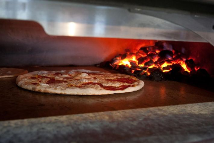 Table 87 uses coal-fired ovens at its two Brooklyn pizzerias.