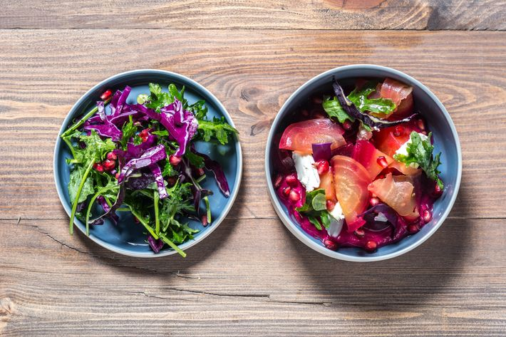 Beet salad with shredded red cabbage, goat cheese, mustard leaves, pomegranate, and raspberry-vinegar dressing.