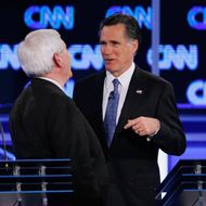 JACKSONVILLE, FL - JANUARY 26: Republican presidential candidates, former Massachusetts Gov. Mitt Romney (R) and former Speaker of the House Newt Gingrich (R-GA) visit during a commerical break in a debate sponsored by CNN, the Republican Party of Florida and the Hispanic Leadership Network at the University North Florida on January 26, 2012 in Jacksonville, Florida. The debate is the last one before the Florida primaries January 31st. (Photo by Joe Raedle/Getty Images)