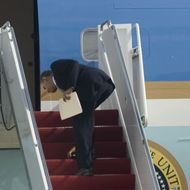 US President Barack Obama bends over to pick up his dropped Blackberry as he boards Air Force One at Andrews Air Force Base, Maryland on February 18, 2010.  Obama is heading to Denver to attend a fundraiser for Senator Michael Bennet and to Las Vegas to attend a DNC fundraiser.   AFP  PHOTO/Jim WATSON (Photo credit should read JIM WATSON/AFP/Getty Images)