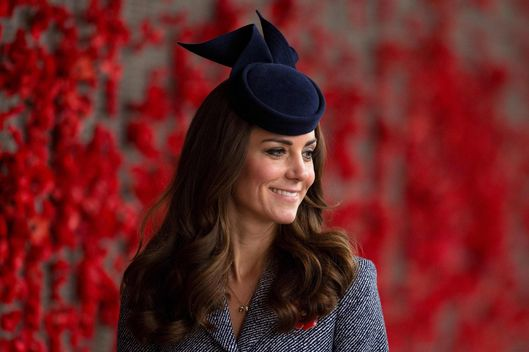 CANBERRA, AUSTRALIA - APRIL 25:  Catherine, Duchess of Cambridge walks along the World War I Wall of Remembrance during their visit to the Australian War Memorial on ANZAC Day on April 25 2014 in Canberra, Australia. The Duke and Duchess of Cambridge are on a three-week tour of Australia and New Zealand, the first official trip overseas with their son, Prince George of Cambridge. (Photo by Mike Dunlee - Pool/Getty Images)