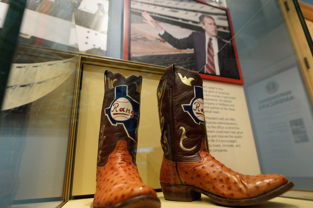 Boots commemorating George W. Bush's tenure as general managing partner of the Texas Rangers are displayed at the George W. Bush Presidential Center on the campus of Southern Methodist University on April 24, 2013 in Dallas, Texas. Dedication of the George W. Bush Presidential Library is to take place on April 25 with all five living U.S. Presidents in attendance and an expected 8,000 invitation-only guests.