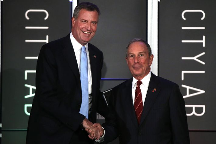 "NEW YORK, NY - OCTOBER 08:  Democratic nominee for New York Mayor Bill de Blasio (L) appears on stage with current New York Mayor Michael Bloomberg at ""CityLab: Urban Solutions to Global Challenges,"" an event sponsored by The Atlantic, The Aspen Institute, and Bloomberg Philanthropies on October 8, 2013 in New York City. The event, which took place on October 6-8, brought together 300 global city leaders, city planners, scholars, architects, artists and others for a symposium on urban ideas.  (Photo by Spencer Platt/Getty Images)"