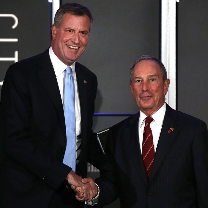 NEW YORK, NY - OCTOBER 08: Democratic nominee for New York Mayor Bill de Blasio (L) appears on stage with current New York Mayor Michael Bloomberg at