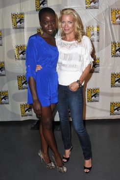 "SAN DIEGO, CA - JULY 13:  Actors Danai Gurira (L) and  Laurie Holden speak at AMC's ""The Walking Dead"" panel during Comic-Con International 2012 at San Diego Convention Center on July 13, 2012 in San Diego, California.  (Photo by Albert L. Ortega/Getty Images)"
