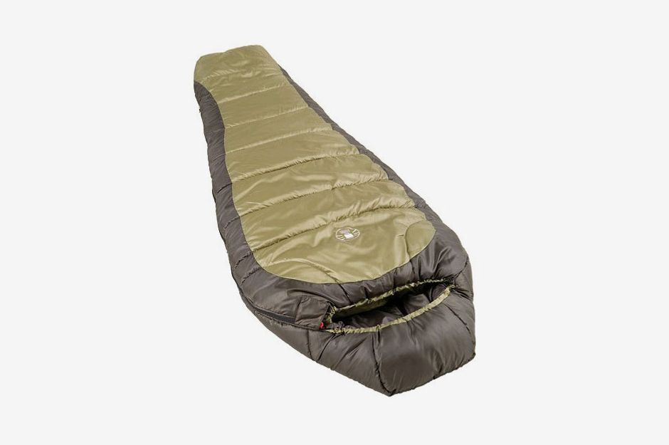 A sleeping bag with a light green body and a jungle green trim on its border