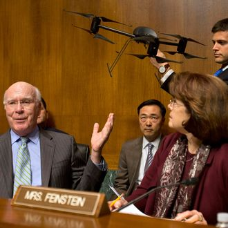 Senate Judiciary Committee Chairman Sen. Patrick Leahy, D-Vt., left, gestures to an example of a drone held by a staff member, on Capitol Hill in Washington, Wednesday March 20, 2013, during the committee's hearing to examine the future of drones in America, focusing on law enforcement and privacy considerations. At right is Sen. Dianne Feinstein, D-Calif.