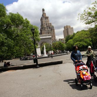 NEW YORK - MAY 23: Women push strollers through Washington Square Park May 23, 2005 in New York City. A renovation is planned for the Greenwich Village park which includes installing a perimeter fence, relocating the signature fountain by approximately 20 feet to line up with the Washington Square Arch, moving both dog runs as well as restructuring pathways. Community reaction has been mixed to the changes, but the $16 million dollar renovation is slated to begin this summer. (Photo by Chris Hondros/Getty Images)