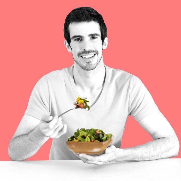 Latin man eating salad