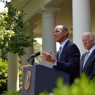 US President Barack Obama speaks in the Rose Garden on immigration reform as US Vice President Joe Biden listens on June 30, 2014 at the White House in Washington, DC.
