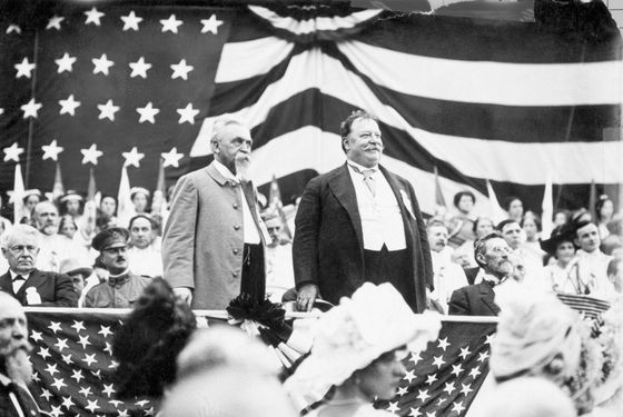 Original caption: Ca. 1908-1912-William Howard Taft stands on an American flag-draped platform to campaign for his election to the Presidency. --- Image by © Bettmann/CORBIS