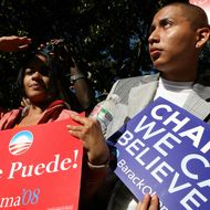 """Supporters of US Democratic presidential candidate Illinois Senator Barack Obama listen during a Latino Town Hall meeting at the Los Angeles Trade Technical College in Los Angeles, 31 January 2008.  Obama, 46, has made """"change"""" the central motif of his campaign, and wants to turn the page on almost 20 years of having either a Bush or a Clinton in the White House.     AFP PHOTO/Emmanuel DUNAND (Photo credit should read EMMANUEL DUNAND/AFP/Getty Images)"""