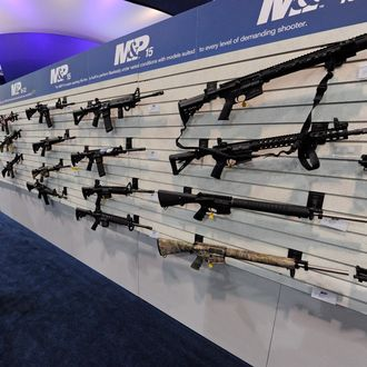 An attendee looks at Smith & Wesson M&P15 MOE Mid rifles at the Smith & Wesson booth at a gun show January 17, 2012 in Las Vegas, Nevada.