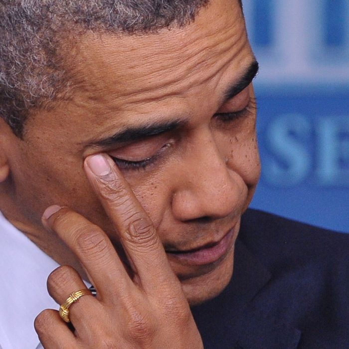 US President Barack Obama wipes his eye as he speaks during a previously unannounced appearance in the Brady Briefing Room of the White House on December 14, 2012 in Washington, DC. Obama spoke following the shooting in a Connecticut Elementary School which left at least 27 people dead.