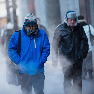 NEW YORK, NY - JANUARY 07: Morning commuters bundle up against the cold on the morning of January 7, 2014 in New York, United States. A polar vortex has descended on much of North America, coming down from the Arctic, bringing record freezing temperatures across much of the country. (Photo by Andrew Burton/Getty Images)