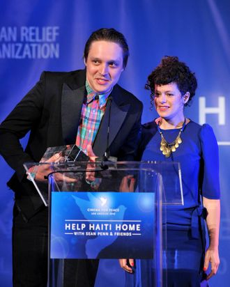 Musicians Win Butler (L) and Regine Chassagne of Arcade Fire speak onstage at the Cinema For Peace event benefitting J/P Haitian Relief Organization in Los Angeles held at Montage Hotel on January 14, 2012 in Los Angeles, California. (Photo by Alberto E. Rodriguez/Getty Images For J/P Haitian Relief Organization and Cinema For Peace)