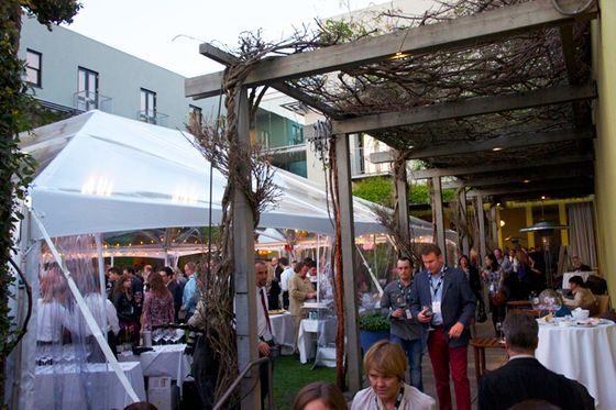 The scene in the courtyard of the Hotel Healdsburg as things got rolling for a Taste of Pigs & Pinot on Friday. In total, 62 Pinot Noirs were being poured at different, alphabetical stations.
