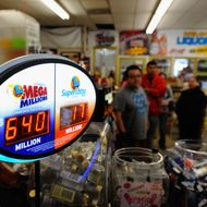 COVINA, CA - MARCH 30:  A sign displays of the $640 Mega Millions jackpot at Liquorland on March 30, 2012 in Covina, California The Mega Millions jackpot has reached a high of $640 million  before the drawing tonight.   (Photo by Kevork Djansezian/Getty Images)