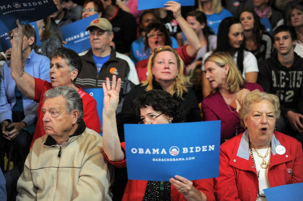 Supporters of US President Barack Obama cheer during a campaign rally where First Lady Michelle Obama is due to speak at the Ohio Wesleyan University in Delaware, Ohio, on October 15, 2012. Three weeks before election day, the White House race between US president Barack Obama and his Republican foe Mitt Romney remains statistically tied, with Obama maintaining just a slight advantage, a new opinion poll found Monday.