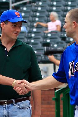 NEW YORK - AUGUST 06: David Wright #5 of the New York Mets shakes hands with prospective Mets owner David Einhorn during batting pracitce before a Major League Baseball game against the Atlanta Braves at Citi Field on August 5, 2011 in the Flushing neighborhood of the Queens borough of New York City.  (Photo by Paul Bereswill/Getty Images)