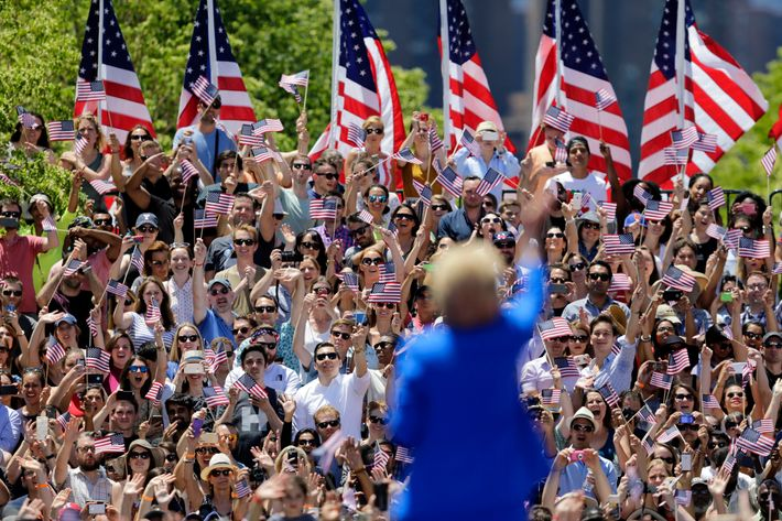 Hillary Clinton waves to supporters Saturday, June 13, 2015, on Roosevelt Island in New York.