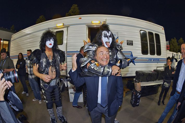 Hockey: Stadium Series: Celebrity performer Gene Simmons of KISS with NHL commissioner Gary Bettman as bandmate Paul Stanley looks on before Los Angeles Kings vs Anaheim Ducks game at Dodger Stadium. Los Angeles, CA 1/25/2014.