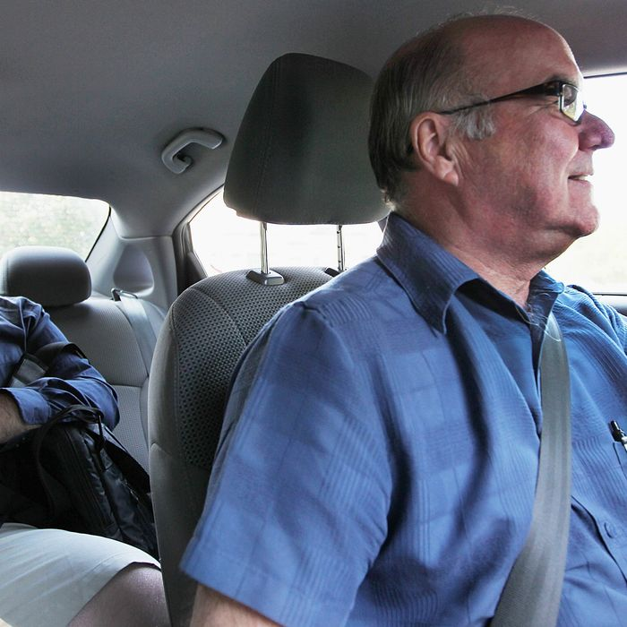 Uber driver Larry Curtis drives Deckard Sorensen, left, from Fenway to St. Mary's Street near Boston University on July 31, 2014.