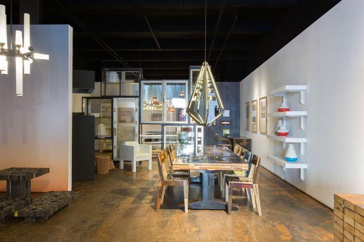 Bec Brittain's Echo 4 chandelier, paired with designer Piet Hein Eek's Waste table.