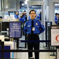 MIAMI, FL - OCTOBER 04: A TSA agent waits for passengers to use the TSA PreCheck lane being implemented by the Transportation Security Administration at Miami International Airport on October 4, 2011 in Miami, Florida. The pilot program launched today for fliers to use the expedited security screening in Miami, Atlanta, Detroit and Dallas/Fort Worth.The lane has a metal detector rather than a full-body imaging machine and passengers will no longer no need to remove shoes, belts, light outerwear, and bags of liquids that are compliant with TSA restrictions. (Photo by Joe Raedle/Getty Images)
