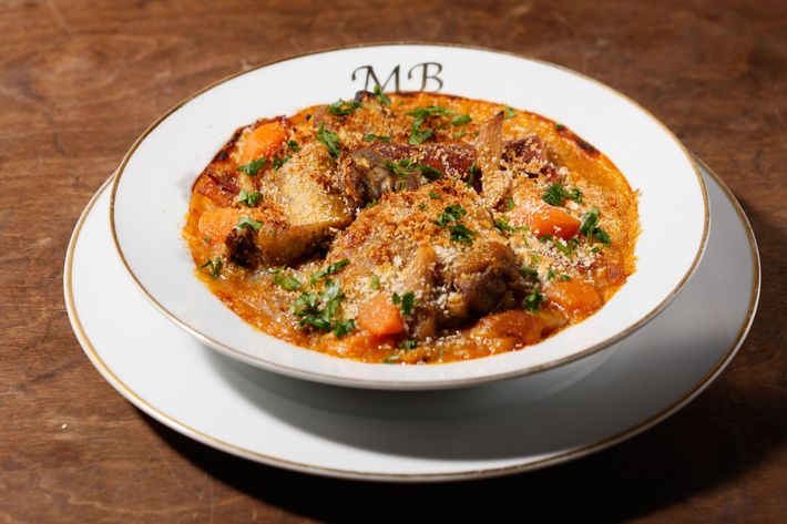 Mountain Bird Cassoulet with duck leg-and-gizzard confit, chicken sausage, carrot, onion, and white beans.