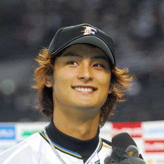 Japanese professional baseball team Hokkaido Nippon Ham Fighters pitcher Darvish Yu smilings during the post-game interview after his win over the Seibu Lions at the Sapporo Dome Stadium in Sapporo in Japan's northern island of Hokkaido on March 27, 2008. Darvish, who is pegged by many scouts in the US to be the next big Japanese pitcher to make the move to the US Major Leagues within the next couple of years, has a 6-1 record by the end of May, 2008 and a Pacific League leading 1.68 ERA. AFP PHOTO / JIJI PRESS (Photo credit should read AFP/AFP/Getty Images)
