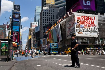 A police officer stands in Times Square in New York, August 12, 2012. New York City Police shot and killed a knife-wielding suspect as he weaved through Saturday afternoon traffic and pedestrians in New York's Times Square, authorities said. Police said Sunday they approached Darrius Kennedy, 51, while he was smoking what appeared to be marijuana. He became agitated and confronted the officers with a knife, a police spokesman said.