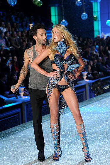 Maroon 5 singer Adam Levine got to walk his girlfriend, model Anne V., down the runway. He was careful not to interact with any of the other models on stage, as he was saving up all that lady-ogling for this photo op. She looks so happy because her lingerie is working. Yaaaayyyy!!!!