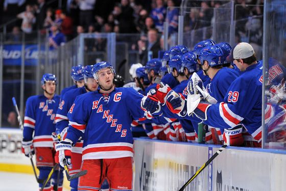 NEW YORK, NY - JANUARY 24: Ryan Callahan #24 of the New York Rangers is congratulated after scoring a first period goal against the Winnipeg Jets on January 24, 2012 at Madison Square Garden in New York City. (Photo by Christopher Pasatieri/Getty Images)
