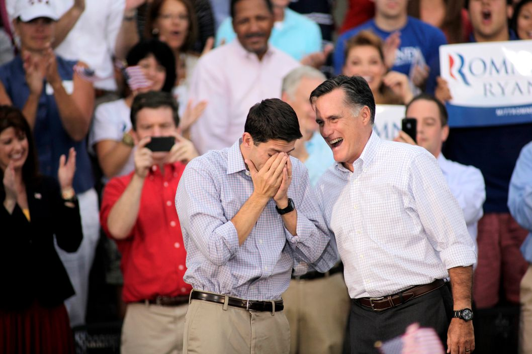 Republican vice presidential candidate and Wisconsin native Rep. Paul Ryan (R-WI) (L) wipes away tears as he and presidential candidate and former Massachusetts Gov. Mitt Romney greet supporters during a campaign event at the Waukesha Expo Center on August 12, 2012 in Waukesha, Wisconsin. Romney continues his four day bus tour a day after announcing his running mate, Rep. Paul Ryan.