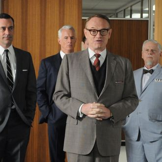 Don Draper (Jon Hamm), Roger Sterling (John Slattery), Lane Pryce (Jared Harris) and Bertram Cooper (Robert Morse) - Mad Men - Season 5, Episode 2 - Photo Credit: Michael Yarish/AMC