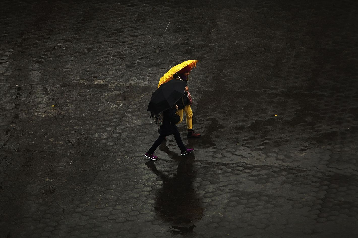 People walk in the rain through Union Square in Manhattan on November 26, 2013 in New York City. New York City is preparing for severe weather as a storm that wreaked havoc in the Southwest over the weekend is turning toward the Northeast. Heavy rains and high winds are predicted for Wednesday, Thanksgiving eve, one of the nations busiest travel days.