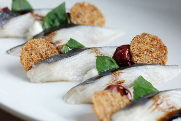 Kombu-cured mackerel with whipped feta, roasted grapes, basil, and rye.
