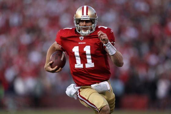 SAN FRANCISCO, CA - JANUARY 14:  Alex Smith #11 of the San Francisco 49ers runs in for a touchdown in the fourth quarter against the New Orleans Saints during the NFC Divisional playoff game at Candlestick Park on January 14, 2012 in San Francisco, California.  (Photo by Jed Jacobsohn/Getty Images)