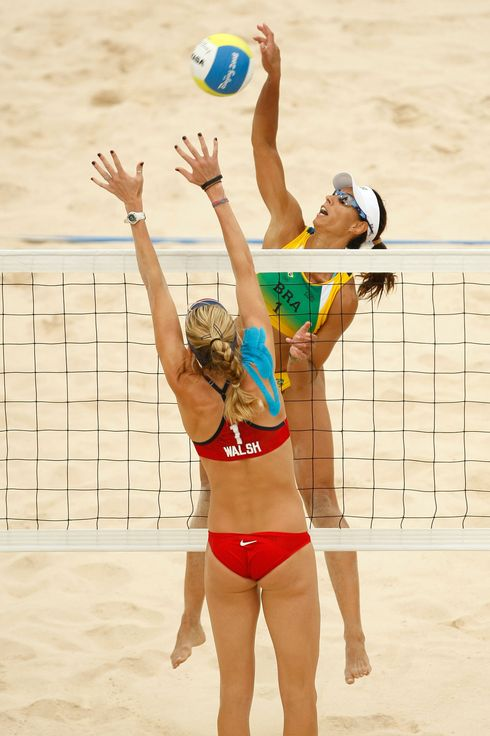 (R-L) Ana Paula Conelly of Brazil goes up for a spike over Kerri Walsh of the United States in the women's quarterfinal beach volleyball match held at the Chaoyang Park Beach Volleyball Ground during Day 9 of the Beijing 2008 Olympic Games on August 17, 2008 in Beijing, China.
